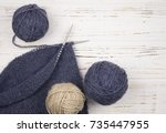 ball of wool with knitting... | Shutterstock . vector #735447955
