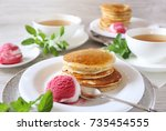 two portions of banana pancakes ... | Shutterstock . vector #735454555