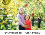 two sisters girls picked up a... | Shutterstock . vector #735459589