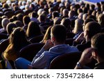 people in the auditorium during ... | Shutterstock . vector #735472864