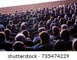 people in the auditorium during ...   Shutterstock . vector #735474229