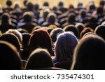 people in the auditorium during ... | Shutterstock . vector #735474301