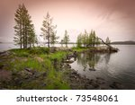 Beautiful northern landscape on the lake in Finland - stock photo