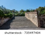 stairs and stone walls. | Shutterstock . vector #735497404
