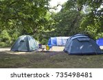 blue and green family camping... | Shutterstock . vector #735498481
