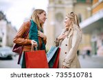 happy friends shopping. two... | Shutterstock . vector #735510781