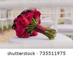 wedding bouquet on white chair. | Shutterstock . vector #735511975