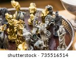 bronze copper and tin figurines ... | Shutterstock . vector #735516514