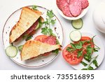 breakfast with sandwiches on... | Shutterstock . vector #735516895