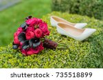 bridal bouquet and shoes on... | Shutterstock . vector #735518899