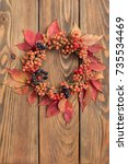 thanksgiving wreath over wooden ... | Shutterstock . vector #735534469