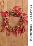 thanksgiving wreath over wooden ... | Shutterstock . vector #735534481