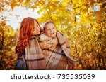 happy mother and her little son ... | Shutterstock . vector #735535039