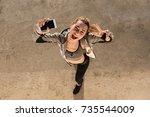 top view of funny brunette... | Shutterstock . vector #735544009