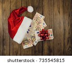 santa's hat and euro currency... | Shutterstock . vector #735545815