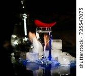 a shot of vodka  an alcoholic...   Shutterstock . vector #735547075