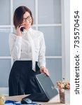 elegant business woman talking... | Shutterstock . vector #735570454