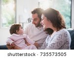 a beautiful couple with their... | Shutterstock . vector #735573505