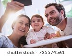 a cheerful young couple and... | Shutterstock . vector #735574561