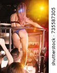 Small photo of Adult woman dancer gogo dancing in the night club on stage