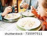 happy family is enjoying pasta... | Shutterstock . vector #735597511