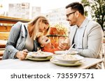 happy family is enjoying pasta... | Shutterstock . vector #735597571