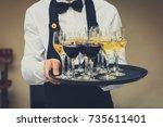professional waiter in black... | Shutterstock . vector #735611401