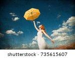 redhead girl holding umbrella... | Shutterstock . vector #735615607