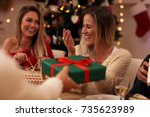 group of friends giving... | Shutterstock . vector #735623989