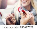 adult man giving engagement...   Shutterstock . vector #735627091