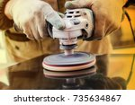 worker polishes a stone with a... | Shutterstock . vector #735634867