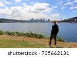 young man on the side of lake... | Shutterstock . vector #735662131