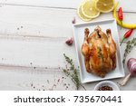 roasted chicken with herbs and... | Shutterstock . vector #735670441