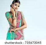 portrait of beautiful indian... | Shutterstock . vector #735673045