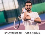 Small photo of Handsome man on tennis court. Young tennis player. Pain in the elbow