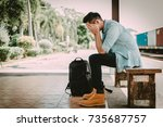 depressed asian traveler man... | Shutterstock . vector #735687757