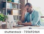 stressed tired mulatto... | Shutterstock . vector #735692464