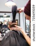 hairdresser making a hair style ... | Shutterstock . vector #735695059