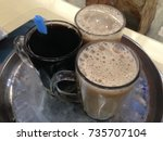 big cup of teh tarik... | Shutterstock . vector #735707104