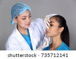 asian doctor nurse check face... | Shutterstock . vector #735712141