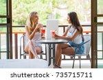 beautiful women sitting in... | Shutterstock . vector #735715711