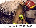 firefighter hoses and helmet | Shutterstock . vector #735717685