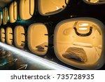 capsule hotel beds in kyoto ... | Shutterstock . vector #735728935
