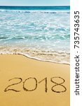 digits  2018 on the sand... | Shutterstock . vector #735743635