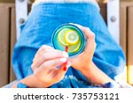 female holding a mason jar with ... | Shutterstock . vector #735753121