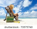 girl on a tropical beach with... | Shutterstock . vector #73575760