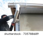 roofer install and repair... | Shutterstock . vector #735788689