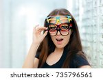 funny woman trying many... | Shutterstock . vector #735796561