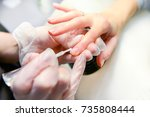manicure in process | Shutterstock . vector #735808444