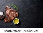grilled t bone steak on stone... | Shutterstock . vector #735823921